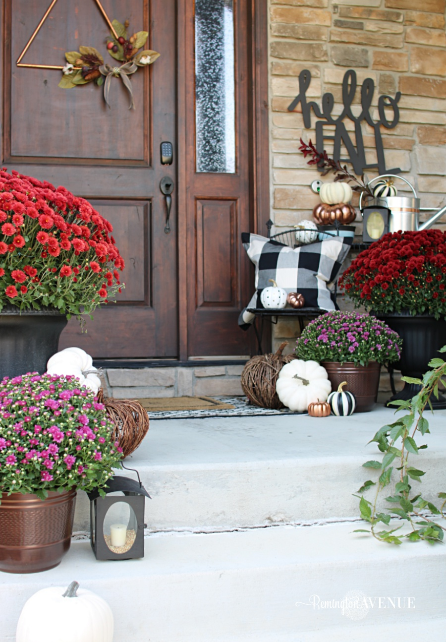 copper, jewel toned fall front porch with bold black and white patterns