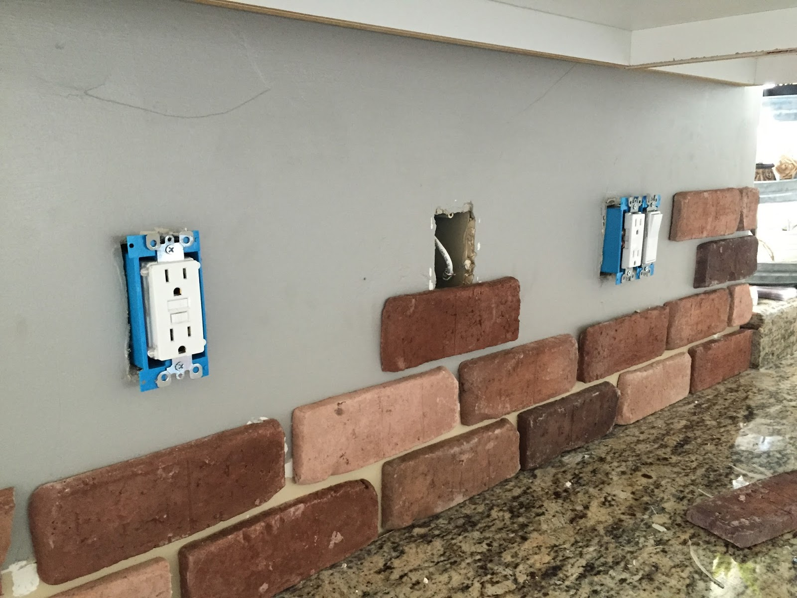 Do it yourself brick veneer backsplash remington avenue on install electrical outlet brick wall Wiring Multiple Switches and Outlets Series Circuit with Outlets