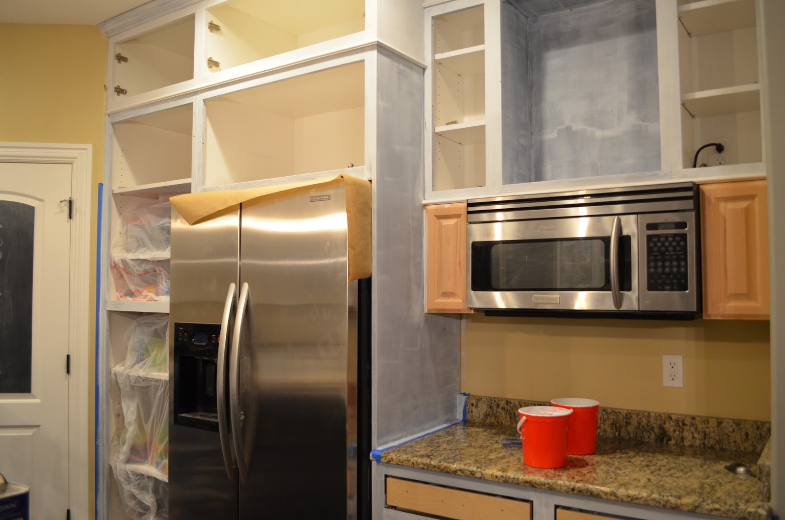 How to paint your kitchen like the pro 39 s remington avenue for Caulking kitchen cabinets