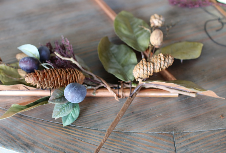 an unconventional approach to fall decor. Super easy copper triangle wreath