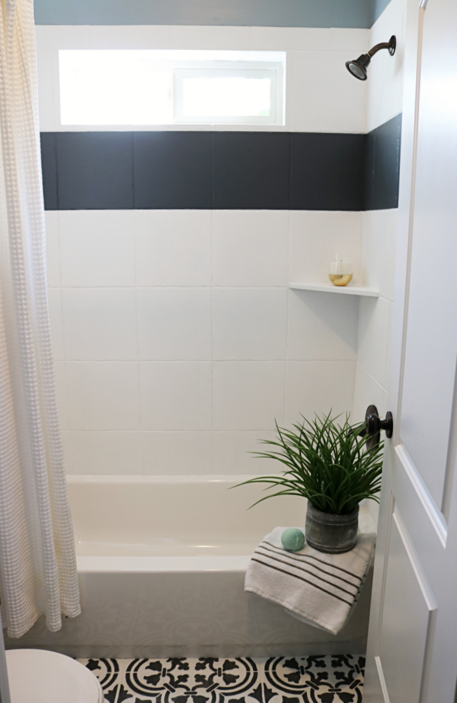 How to paint shower tile remington avenue ill keep you posted on how my shower is holding up dont worry if you have more then an ugly tile shower surround aka and ugly bathtub dailygadgetfo Image collections