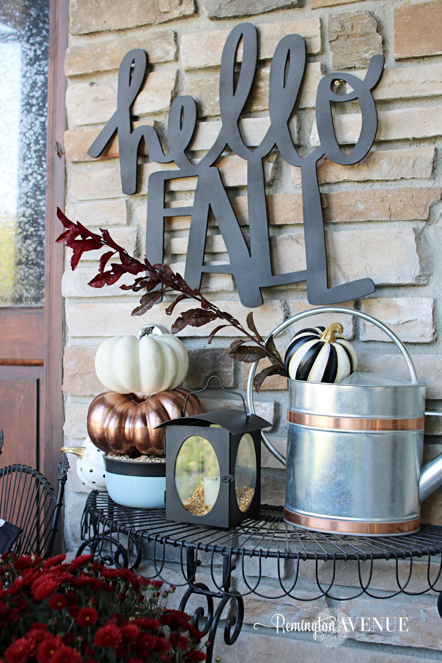 "I greet the new season (and my guests) with this ""Hello Fall"" sign.  It can be seen from the street and what a fun way to add a little personality to your fall porch.  This sign comes in 2 different sizes.  Mine is the large and I painted it with this charcoal gray chalk spray paint.  You could even hang it on your door, or over a wreath.  Lot's of options."