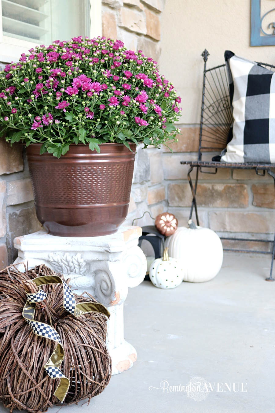 copper & jewel toned fall front porch with bold black and white patterns