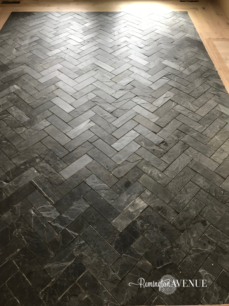 slate herringbone entry way- a timeless and durable rug inlay