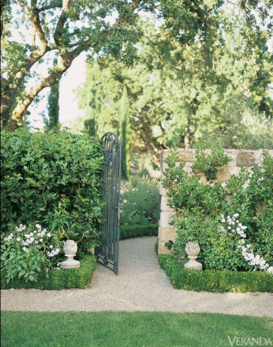 traditional french country garden design - stone elements