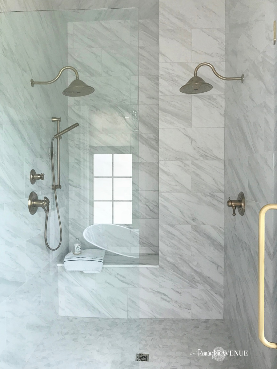 marble master bathroom with wood lattic inlay