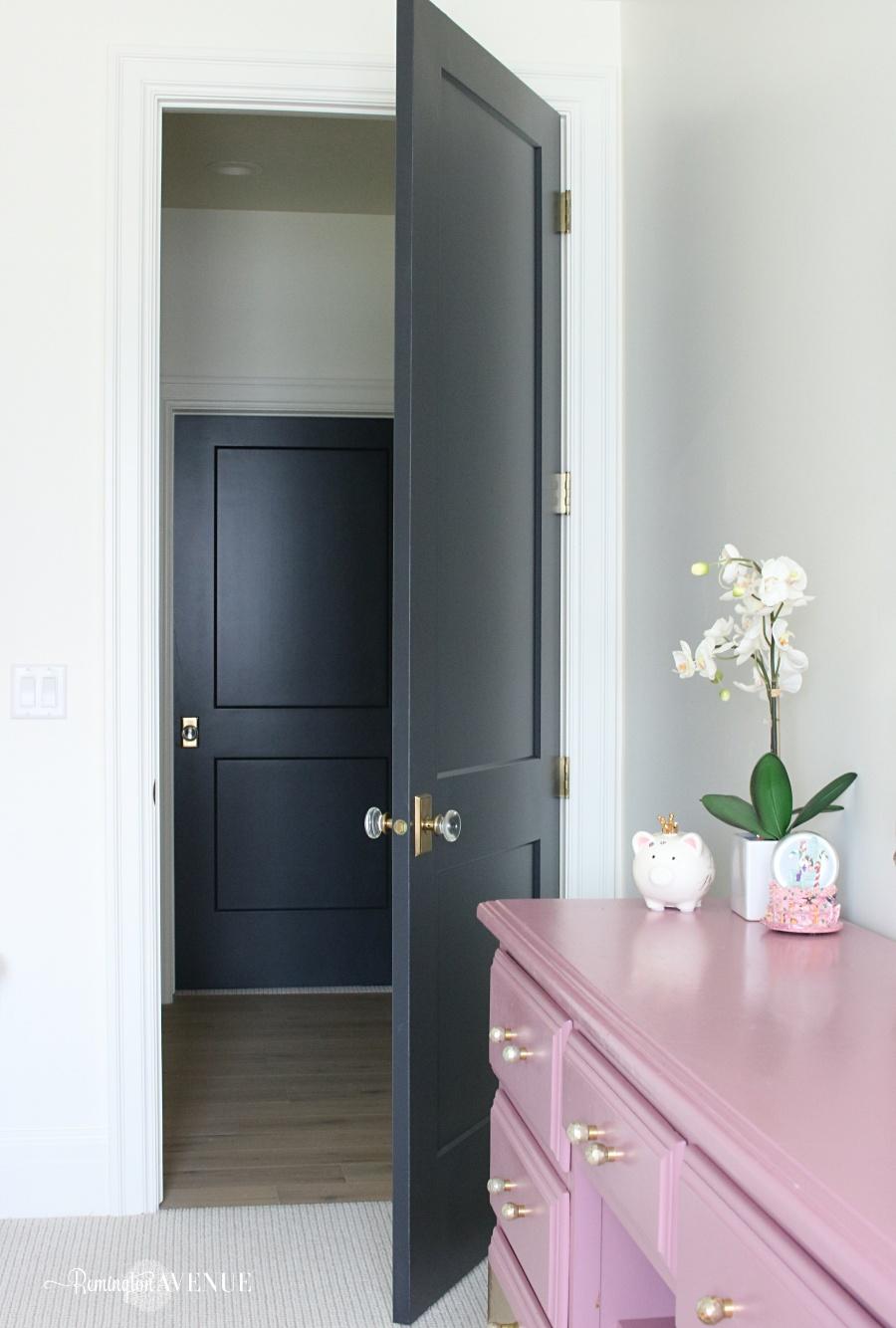 white interoir with dark doors