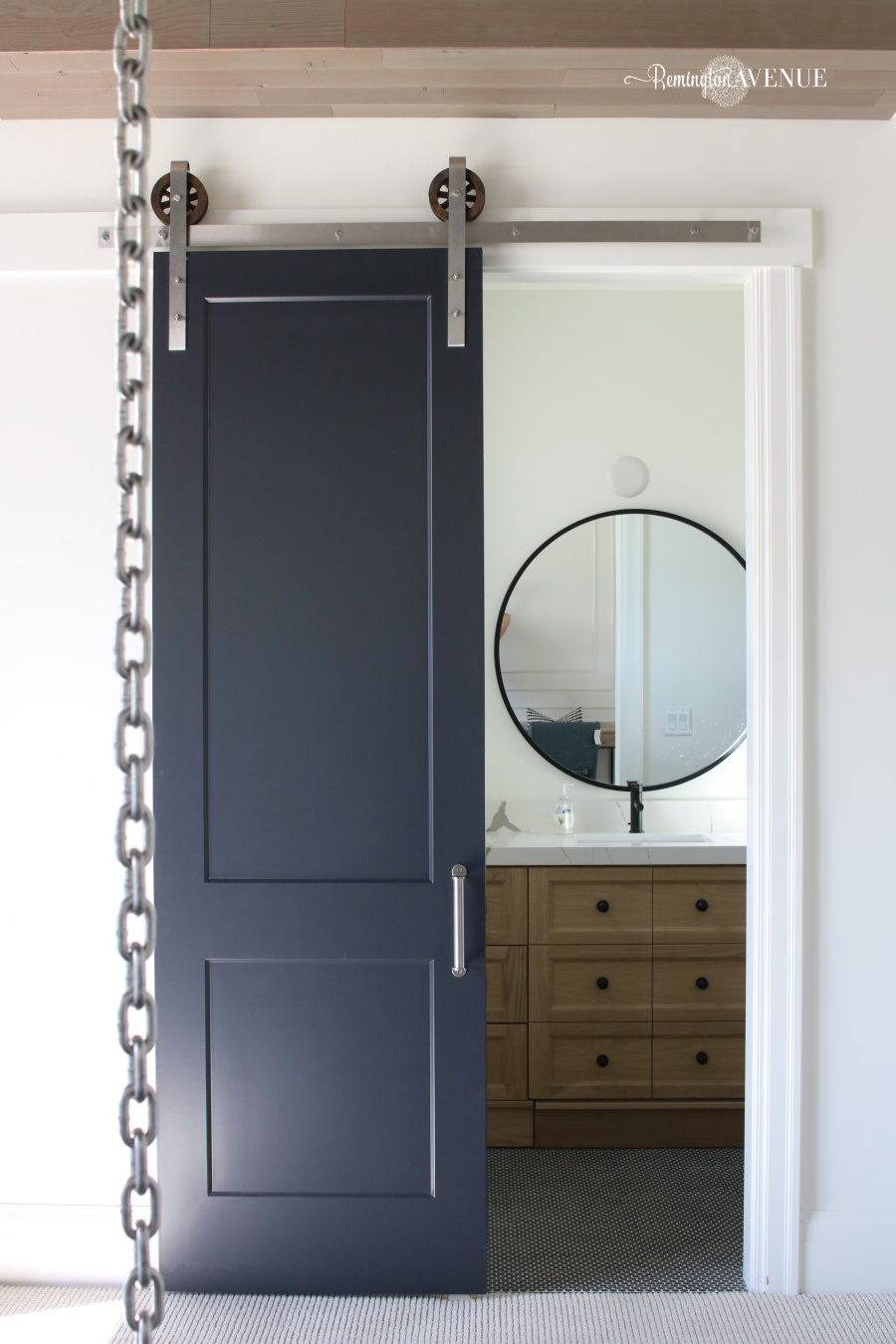 Modern industrial boys bedroom design with stainless steel and wood accents