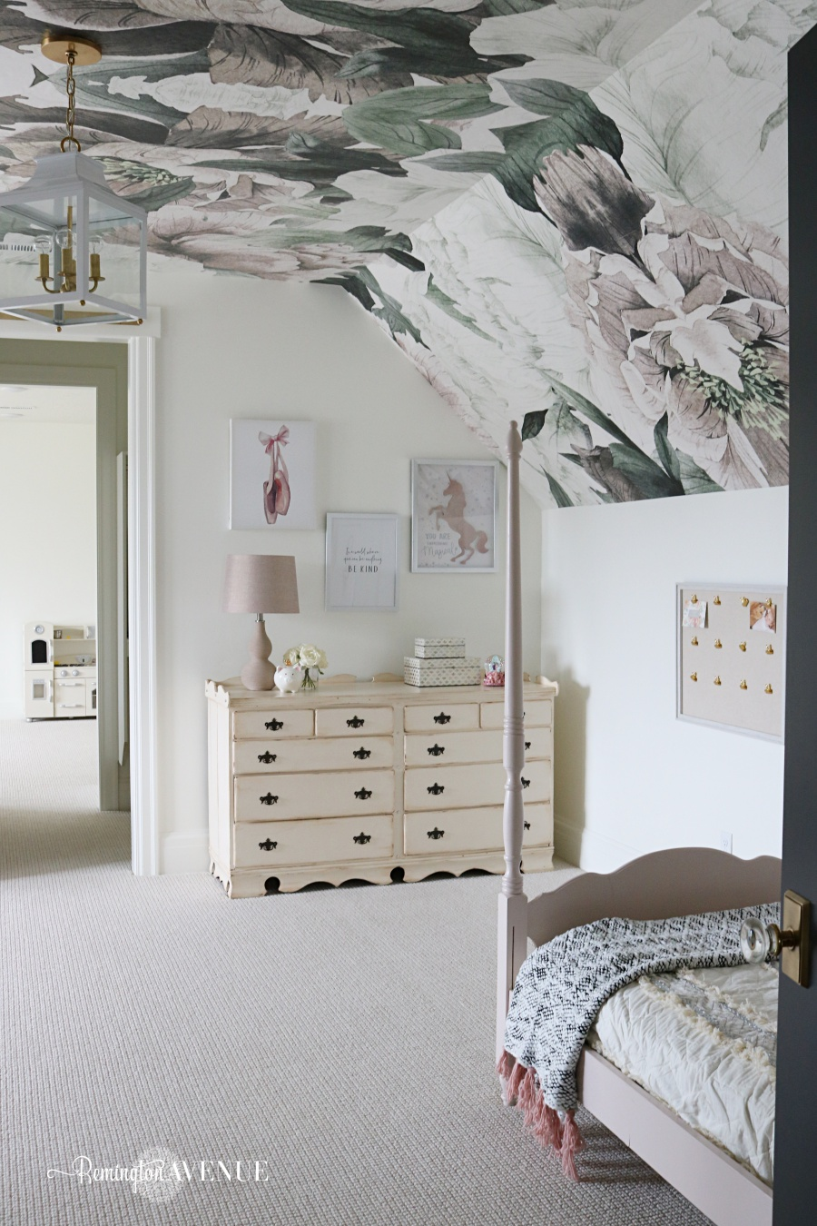 Shared girls bedroom with floral wallpaper