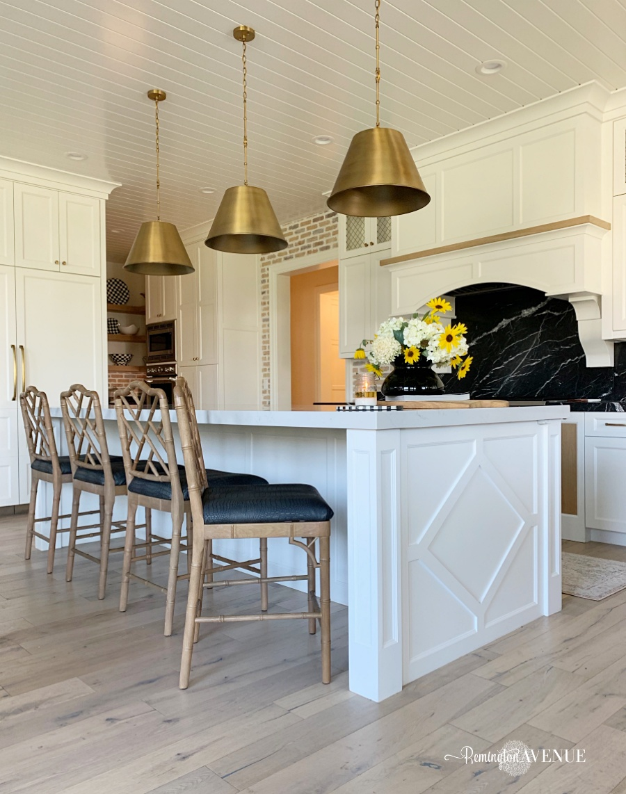 upholstered barstools in a french country kitchen