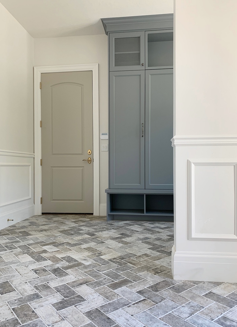elegant laundry:mudroom with herringbone brick floor 4
