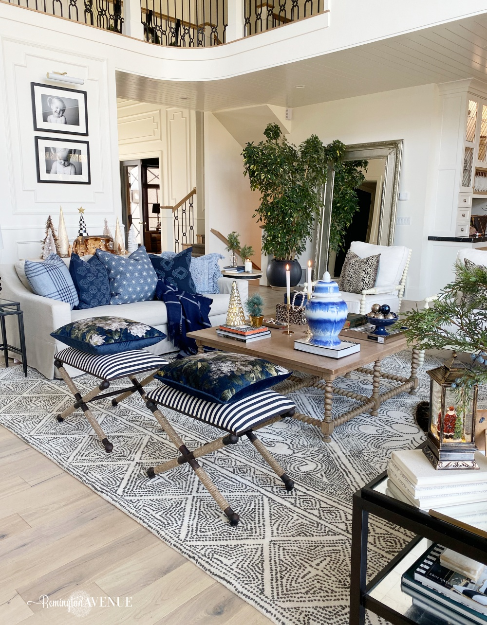 holiday living room with mixed prints, blue, and metallics