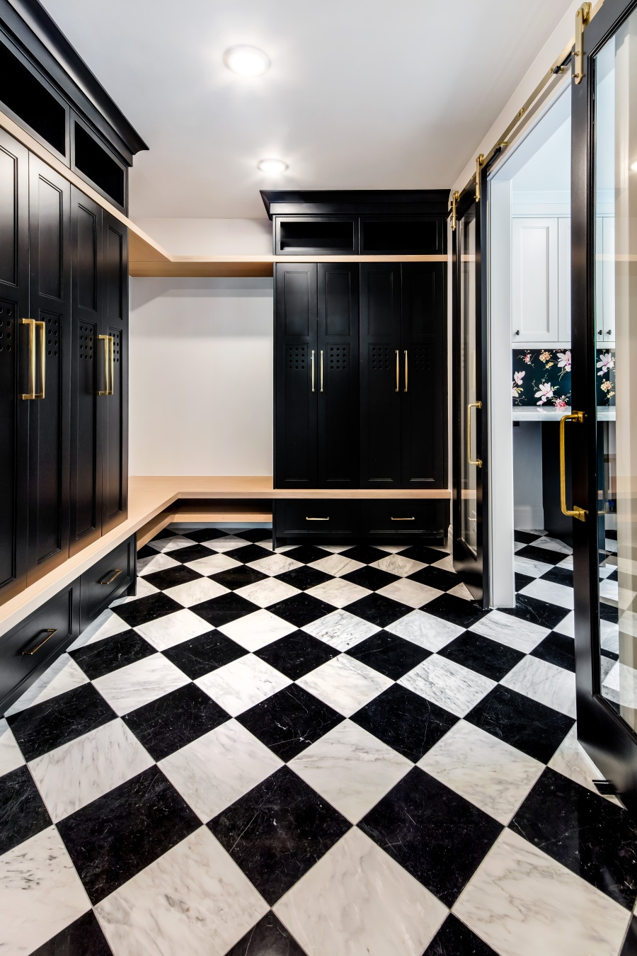 black and white marble floor in mudroom