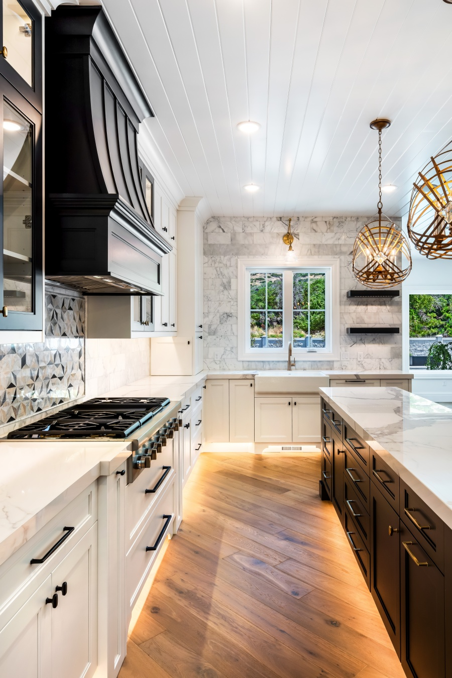 black and white kitchen with warm wood floors
