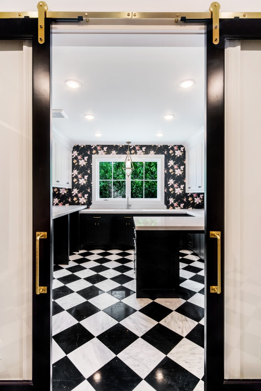 black and white laundry room with floral wallpaper