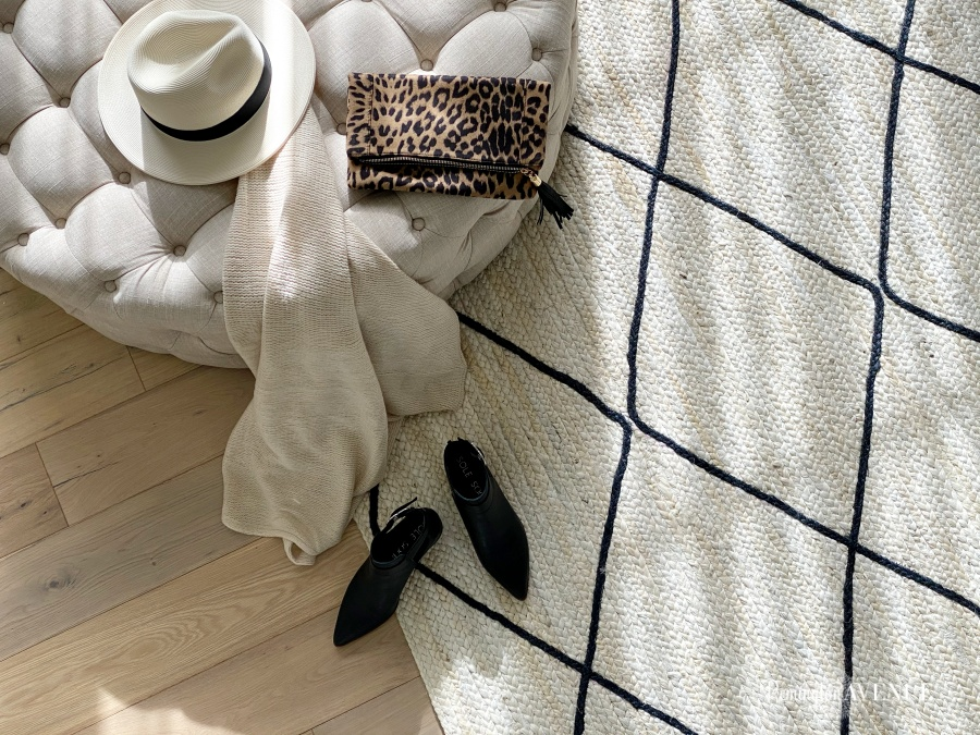 natural woven rug with black diamond pattern