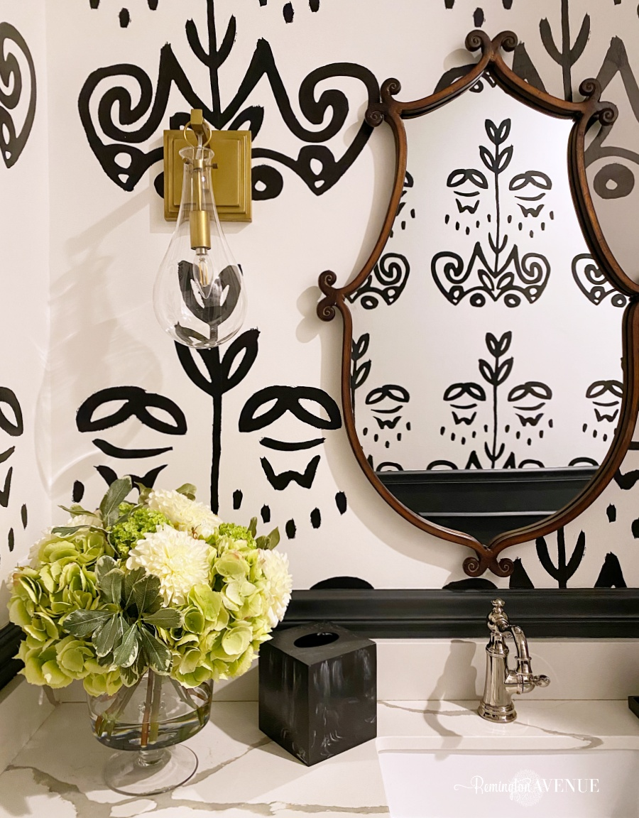 black and white powder room with mixed metals