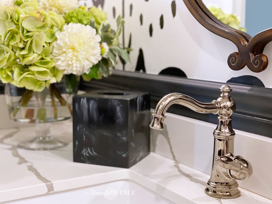 black and white powder room with polished nickel faucet