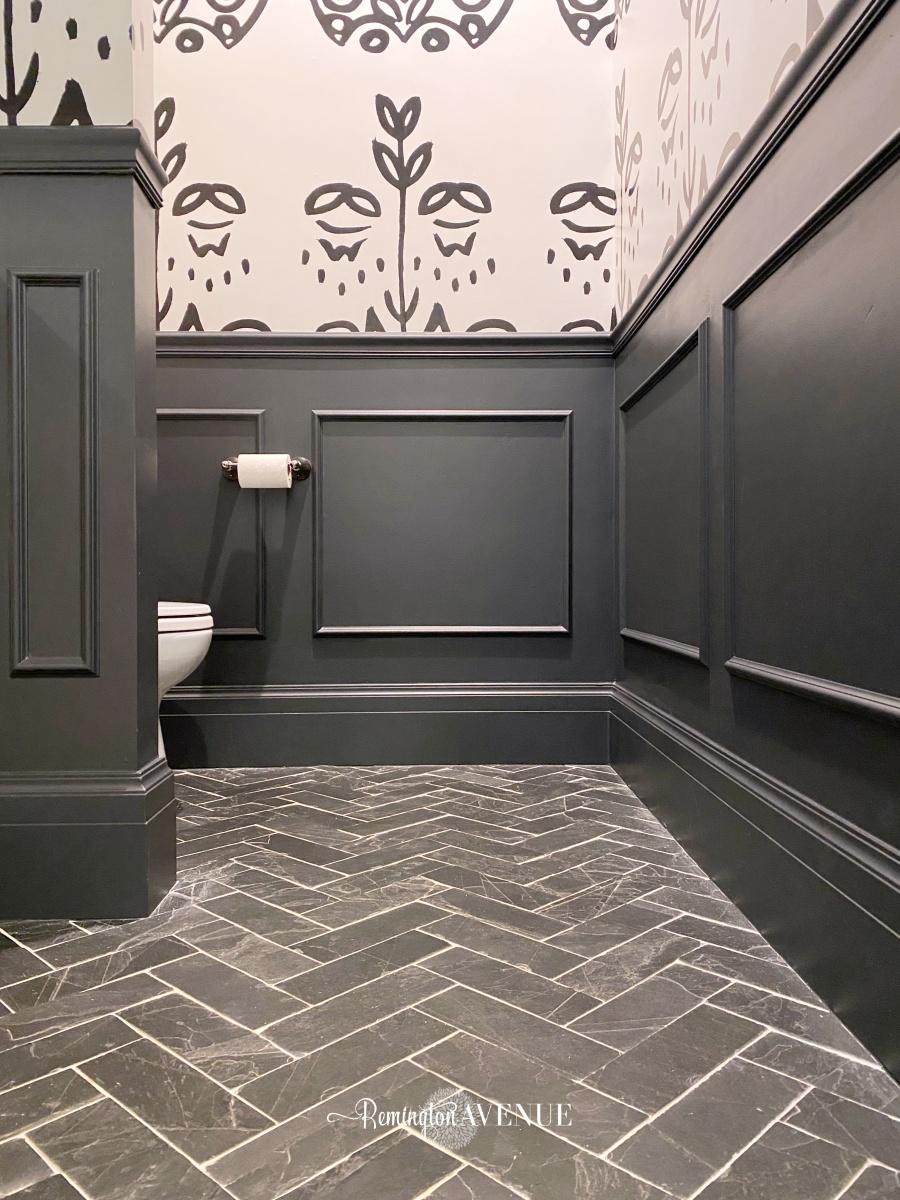 black and white bathroom with herringbone slate floor