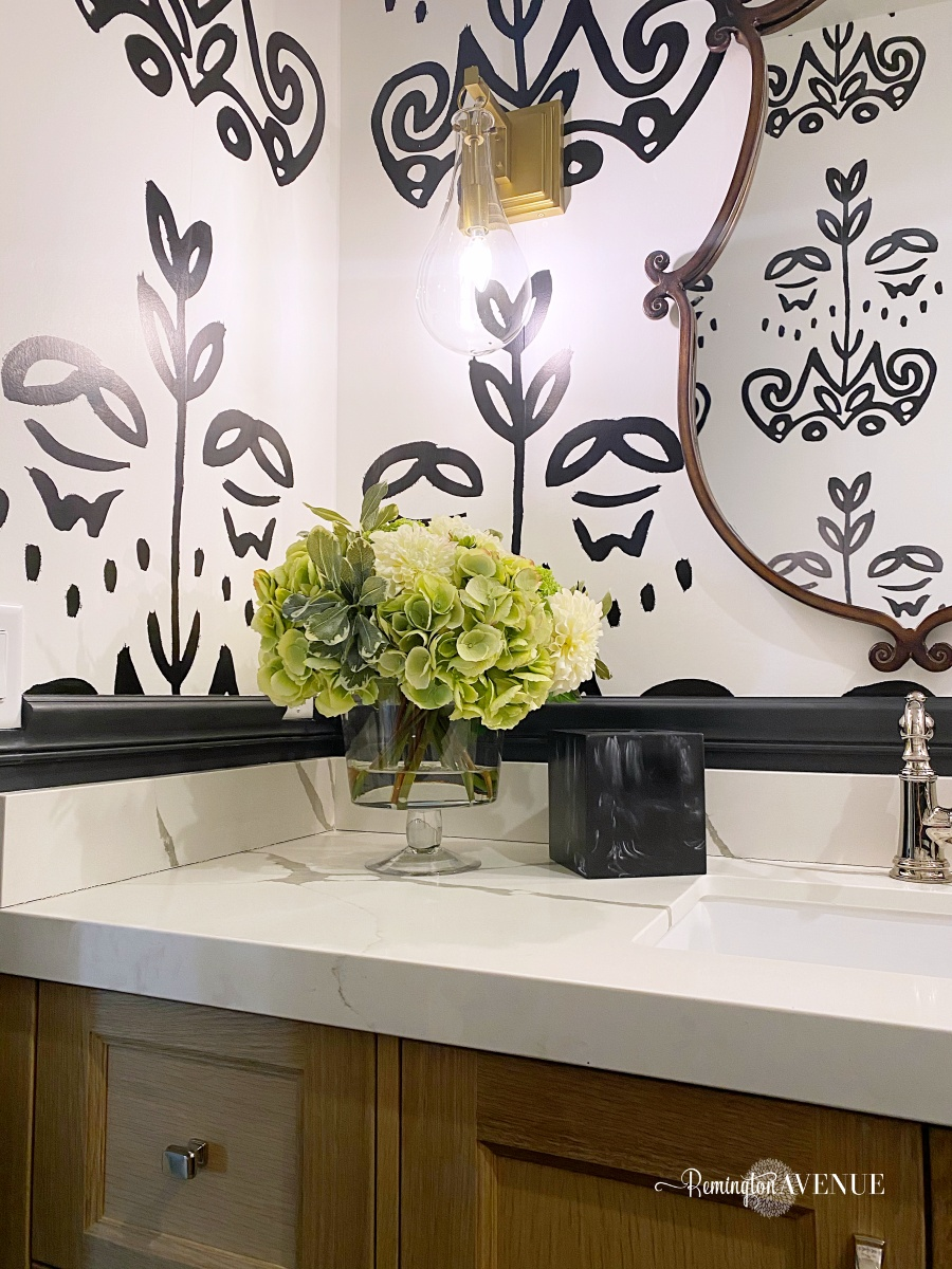black and white bathroom with quartz counter top