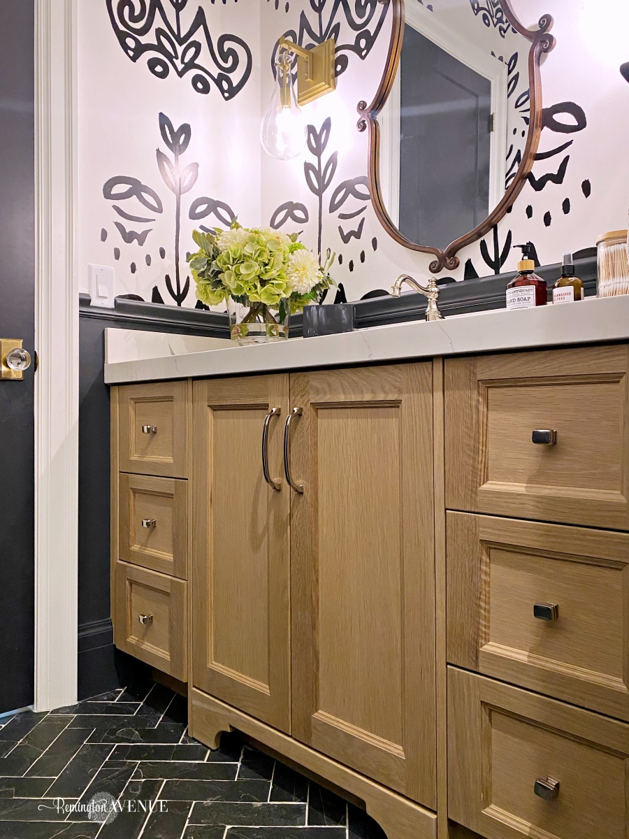 black and white bathroom with white oak vanity