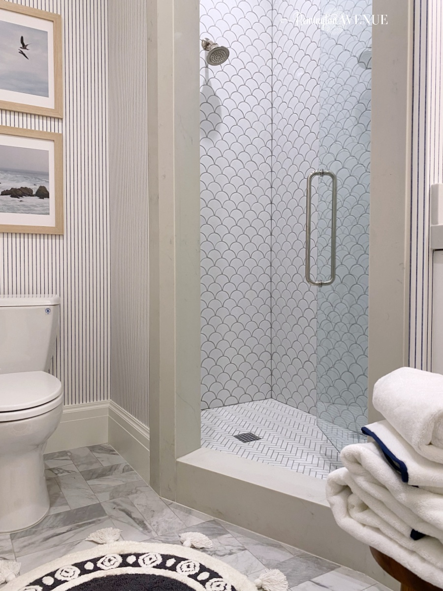 marble guest bathroom reveal with scallop shower tile