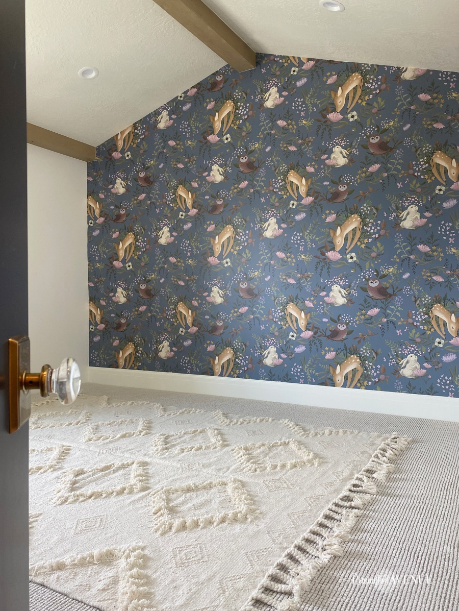 natural nursery rug with diamond pattern